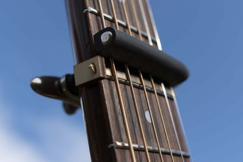 Capo Elevator attached to guitar.